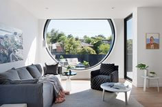 House in Melbourne with large round windows