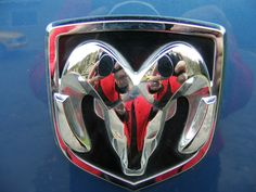 Dodge Ram logo on blue dodge ram truck
