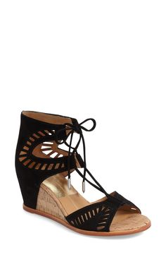 These suede wedge sandals from Dolce Vita are a must have! Geometric cutouts, lace-ups, and a wedge heel lend to the trendy feel.
