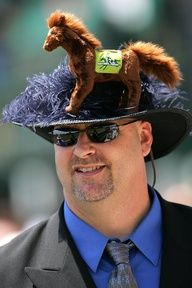 A man who knows how wear embrace a love of stuffed animals... for Derby Day