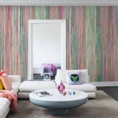 Stripes are a versatile and familiar image. Always sophisticated and chic they can add dimension and a graphic punch to your rooms. The stripes wallpaper from our Spectrum range is a stimulating combination of soft colours; producing an effect of coloured rain. Imagine how different a wet day would be if we had colourful rain! Made with real paint the mural gives depth and substance, placed vertically or horizontally to achieve the effect you are looking for. Any room would benefit from…