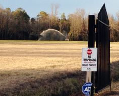 A sprayer soaks a field with liquified manure and urine from a large-scale hog farm in Duplin County, North Carolina.