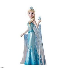 A stunning and highly intricate figurine from Disney Showcase. Showcasing Elsa from Disney favourite Frozen wearing her stunning blue gown complete with snowflake and pearl detailing. Holding a pretty blue snowflake style star, this Elsa figurine is a must have addition to any collection and for fans of this much loved film.