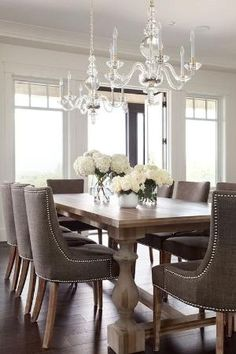 Restoration Hardware 17c monastery table and Martine upholstered armchairs, chandeliers by betsysand