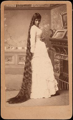 A lovely young Victorian woman shows off her impressive head of wavy hair -- worthy of Rapunzel. Looks like waves from tight braiding.