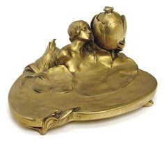 A FRENCH ART NOUVEAU GILT-BRONZE FIGURAL ENCRIER, CAST FROM A MODEL BY MAURICE BOUVAL, CIRCA 1900, INSCRIBED 'M. BOUVAL' AND STAMPED 'E. COLIN & CIE. PARIS'
