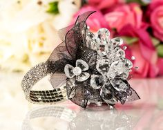 Prom Corsage | Crystal Flowers Corsage with Black Glitter Ribbon  THIS is such a fantastic idea!  Use an actual rhinestone bracelet instead of an elastic band!  I LOVE IT!!!
