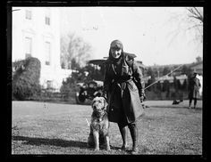 Laddie Boy, stands with female pilot Harris & Ewing, photographer 1922