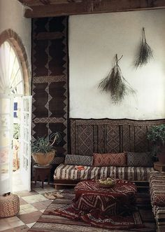 divan styling: drape everything in moroccan capes & carpets...