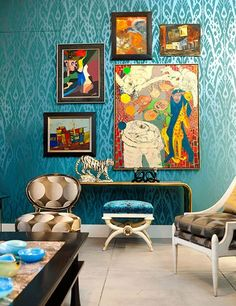 Jim Thompson's Stunning New Atlanta Showroom...SWOON! Teal ikat walls, vibrant paintings hung salon style & enviable graphic upholstery on traditional furniture.
