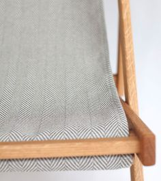chevron outdoor fabric in grey and cream on white oak patio chair