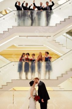 Wedding photo on a staircase! This is so cute, look at all the expressions! ... Ladies on balcony? Men on front porch?