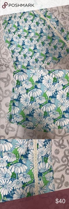 """Lilly Pulitzer Daisy Skort ·      About the Item: Blue and Green Daisy Print   ·      Approximate Measurements: Waist 14"""" Hips 21"""" Shorts Inseam 8"""" Length 20"""" Lilly Pulitzer Skirts Midi"""