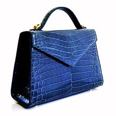 Whether the handbag is leather, denim, hobo, a beaded handbag is sewn with numerous kinds of beads to form a pattern. Handbags On Sale, Purses And Handbags, Leather Purses, Leather Handbags, Shoulder Handbags, Shoulder Bag, Crocodile Handbags, Womens Designer Bags, Leather Keychain