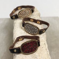 Make your #ootd pop with these gorgeous #blingbracelets featured by a brown leather snap strap! #shoppaisleygrace #accessories