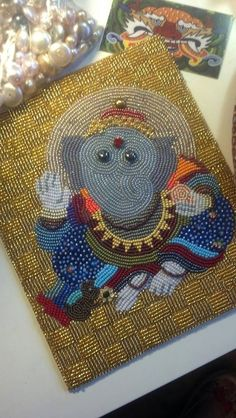 Lord Ganesha was a commissioned piece by one of my doctors as a gift for his wife.  I hope he loves it as much as I do.  Completed in bead embroidery