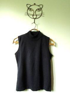 #black turtleneck #sleeveless tank top  #black sweater