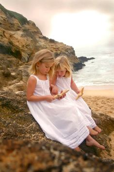captivated...love beach scenes with white dresses on little girls.