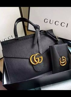 7a114dccd27 Handbags   Wallets - Gucci Small GG Marmont Leather Top Handle is a  structured bag but the signature leather is soft and featherweight.