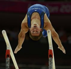 Samuel Mikulak of the U.S. competes in the parallel bars event during the men's gymnastics qualification in the North Greenwich Arena during the London 2012 Olympic Games July 28, 2012