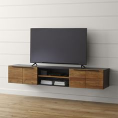 "Shop Rigby 80. 5"" Large Floating Media Console.   Whether paired with its steel tube base or wall mounted on its own, the floating media console offers combined open and concealed storage with two doors, three shelves and plenty of cord management."