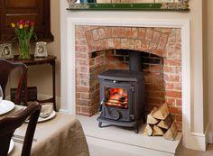 Znalezione obrazy dla zapytania brick wood stove