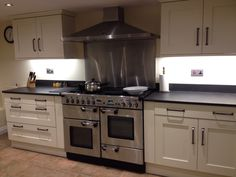 Modern kitchen with a slate kitchen worktop and double sized range cooker