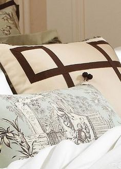 """Add elegance to your bed with the beautiful Vera 20"""" sq. Accent Pillow that pays homage to the French Silk Road."""