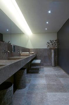 Restaurant bathroom. Natural stone   indirect lighting. Calm and luxurious.