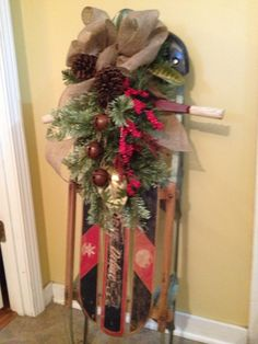 decorated old sleds | Vintage snow sled decorated for Christmas | Winter