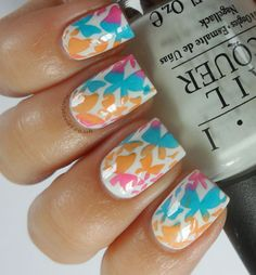 I am loving the Nail Stories blog. This girl is very creative and talented. This design may look like decals, but they're not! She did it with stamping. You've got to check out her other designs: http://nailstoriesuk.blogspot.com