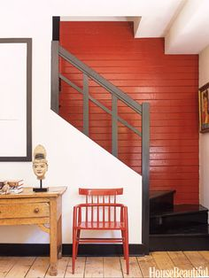 Red Feature Wall teamed with White Walls and Black Trim and natural warm honey coloured timber floor and furnishings the complete look! Visually Warm colours come towards you and cool colours fall to the back, making this colour scheme work fabulously in this space.