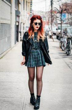 Plaid dress! Black chunky boots, leather jacket, sun glasses...very 90's grunge