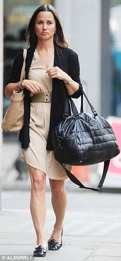 Looking good: Miss Middleton looked elegant in her floaty beige dress and neatly tailored ...