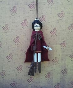 Perfect ornament for the Harry Potter fan. Harry is wearing his qudditch uniform,Gryffndor house crest patch and holding his broomstick.