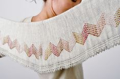 Winter Romance is a light shawlette that will be perfect for your small yarn leftovers. The wave pattern is easy to work, and the border gives a feminine touch. The shawl is worked with some short rows at the middle.