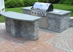 builtin grill with an island - Outdoor Kitchen Cabinets