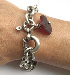 A highly coveted rare RED seaglass gem is the focal point of this amazing heavy vintage sterling silver cable chain bracelet. The gorgeous seaglass was