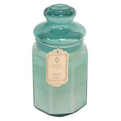 """Jar with lavender scented candle.  Product: CandleConstruction Material: Glass and waxColor: BlueFeatures:  Lavender scent18"""" Ounce capacity Dimensions: 7.5"""" H x 4"""" Diameter"""