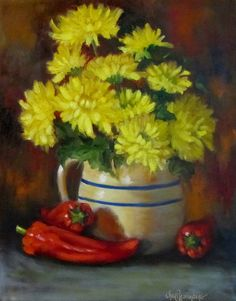 Bright yellow mums are placed in this crock pitcher with red chilies added for a punch of color in this still life painting. The background is