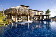 Enormous infinity pool with Tiki bar http://luxury.homeaway.com/vacation-rental/p294244vb