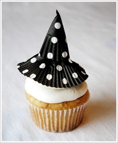 Little cupcake topper witch hats made out of cupcake liners.  Bonus- it covers up a lot of the frosting, perfect for bad frosters like me!