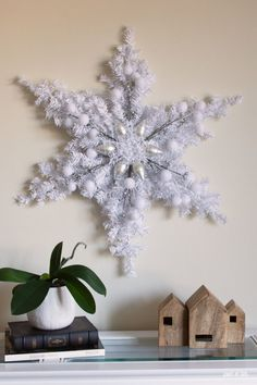 DIY Christmas Decoration: Dollar Store Snowflake Wreath Create a stunning DIY Christmas Decoration Snowflake Wreath using mini artificial Christmas trees and your choice of decorations from the Dollar Tree. Diy Christmas Snowflakes, Snowflake Wreath, Dollar Tree Christmas, Christmas Wreaths, Christmas Crafts, Origami Christmas, Christmas Lights, Christmas Ornaments, Diy Snowman Decorations