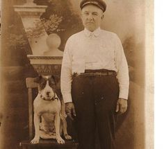 This man was only identified as the city marshall. We don't know his history, but you can make out the badge on his shirt.    Not surprising, the marshall's four legged deputy is the same type of dog many of us have curled up at our feet right now.    Photo courtesy of Animal Farm Foundation.