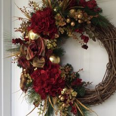Christmas Wreath-Winter Wreath-Holiday Wreath-Holiday Hydrangea Wreath-Christmas Decor-Designer Wreath-Elegant Holiday Wreath-Luxury Wreath  Celebrate the holidays in high style with this exquisite wreath. Scotch pine, white pine, seeded eucalyptus and deep brown huckleberry foliage create a lush bed for gorgeous deep red hydrangea and glittered floral branches centered around a luxurious plaid satin bow. Glittery gold grasses add even more sparkle along with elegant gold ball ornaments and…