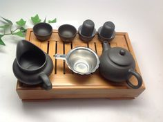 A -Black Yixing clay tea set with tea tray, come with clay pot 6oz, serving pot 4oz, 4 tea tasting cups and 2 aroma cups. and a strainer. only $59.95 B -Set come with