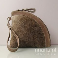 Leather clutch made of beige brown cow hair on hide