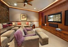 All the amenities of home and movie theater combine in this comfortable entertainment room.