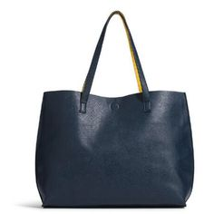 """Reversible tote Very sturdy yellow or navy tote with small pouch                      • MAGNETIC CLOSURE • REVERSIBLE • DETACHABLE WRISTLET • 17""""W X 13""""L X 5.5""""D • 23.5"""" STRAP DROP • LEATHER LIKE • SPOT CLEAN • IMPORTED Bags Totes"""