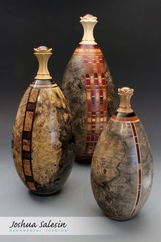 """Hollow vessel urns with segmented staved designs from a variety of domestic and exotic woods. Rose-engine turned """"lotus"""" finial with threaded enclosure and interior cabochon. Pet Urns, Temperature And Humidity, Cremation Urns, Lathe, Wood Turning, Seasonal Decor, Contemporary Design, Woods, Engine"""